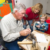 Grove craftsman Tom Thompson crafts a custon ring for Tylee Hobbs, 3, of Pittsburg as her grandmother Robin Glover, also of Pittsburg, looks on during the 27th Annual Cecil Floyd Craft Show on Saturday at the school.<br /> Globe   Laurie Sisk