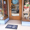 "An ""Our Place is Your Place"" doormat invites shoppers into Blue Moon Boutique, which is among many downtown shops preparing for Small Business Saturday.<br /> Globe 