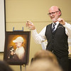 Globe/Roger Nomer<br /> Brad Belk displays cookie cutters with Percy's image during Wednesday's memorial service for the museum cat at the Joplin History Museum.