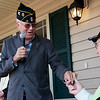 Globe/Roger Nomer<br /> Warren Turner, commander of American Legion Post 13, gives a set of keys to Ronald King for his new Habitat home on Friday.