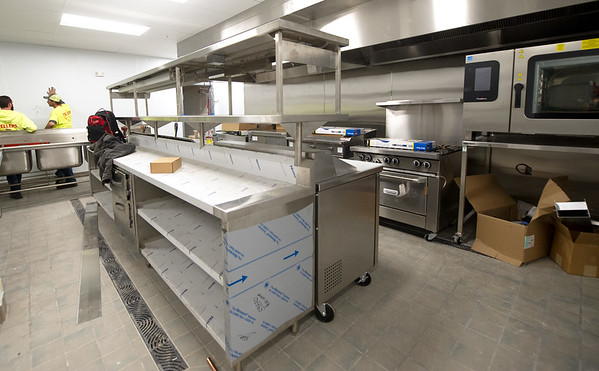 With new equipment installed, workers put the finishing touches on the kitchen inside the new Holiday Inn on Range Line on Wednesday.<br /> Globe | Laurie Sisk