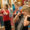 Globe/Roger Nomer<br /> Hayden Fort, Mark Twain Elementary third grader, works on a Christmas song performance on Tuesday at the Webb City school.