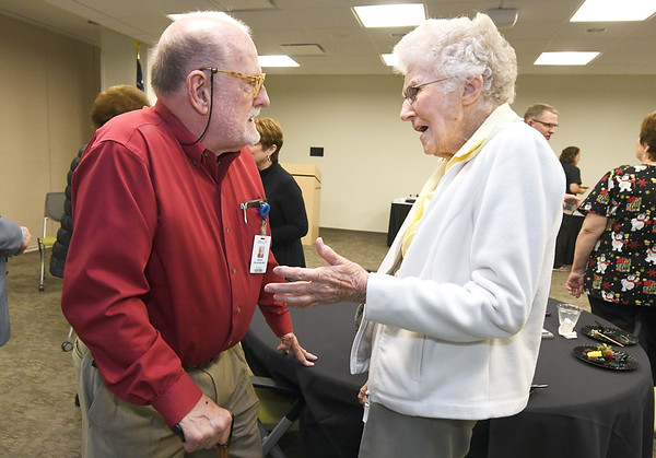 From th left: Dr. W.C. Dandridge, Jr. visits with longtime patient Margaret Davis, of Webb City, during a reception on Tuesday at Mercy Joplin for Dandridge, who plans to retire after 41 years of service to St. John's and Mercy Hospitals. Dandridge, who is credited for helping bring 3D mamography to Joplin, was Davis' surgeon during her battle with breast cancer more than 20 years ago.<br /> Globe | Laurie Sisk