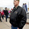 Vietnam veteran Rex Mitchell watches as parade entries make their way down Main Street during the Veterans Day Parade on Saturday in downtown Jolin.<br /> Globe | Laurie Sisk