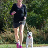 """""""Willodean"""" appears more than happy to comply with the idea of a morning run as Joplin Humane Society volunteer Kelly Johnson keeps pace on Thursday at the Joplin Humane Society.<br /> Globe 