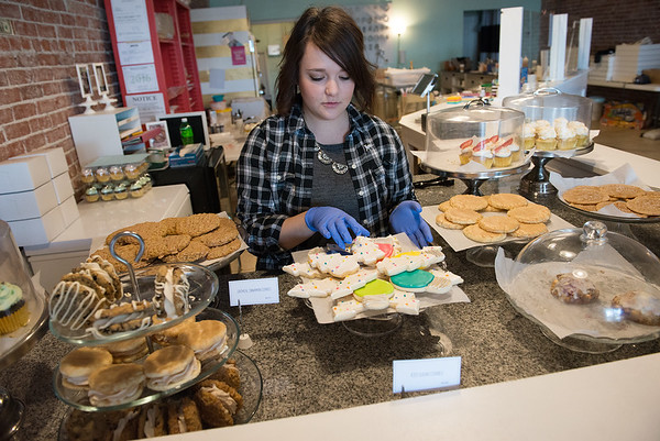 Globe/Roger Nomer<br /> Kristen Radaker Sheafer, owner, works at Frosted Cakerie on Wednesday.