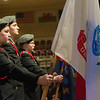 Globe/Roger Nomer<br /> Joplin High School ROTC members hold flags to honor the branches of the military during Thursday's ceremony at College Heights.