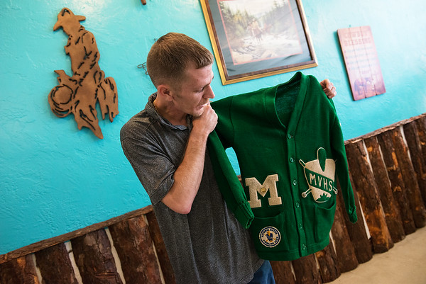Globe/Roger Nomer<br /> Daniel Reeb, owner of The Mountaineer, talks about a vintage Mt. Vernon High School letter jacket during an interview at the restaurant in Mt. Vernon on Thursday.