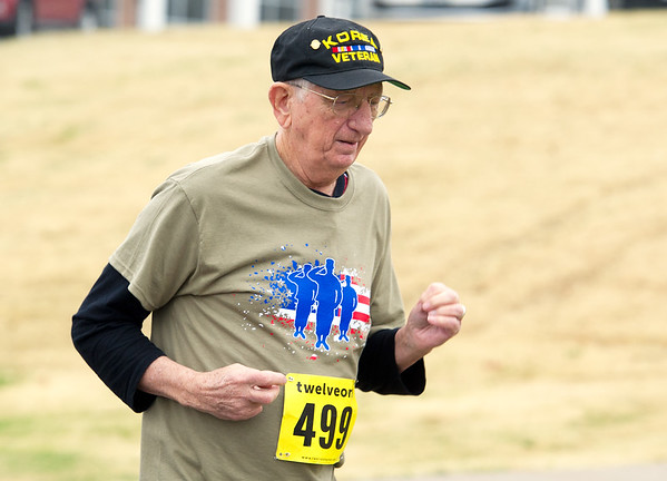 Korean War veteran Dave McCoy, 86, of Carthage, runs the course during the Run with the Heroes 5K on Saturday at Missouri Southern. The event kicked off a week full of veteran-related events, which will conclude Friday with a Veterans Day ceremony open to the public at 11:3o a.m. on the Oval.<br /> Globe  Laurie Sisk