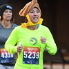 Johnna Davis digs deep for a little extra as she nears the finish of the 5k race during the Joplin Turkey Trot in downtown Joplin on Thanksgiving morning.<br /> Globe | Laurie Sisk