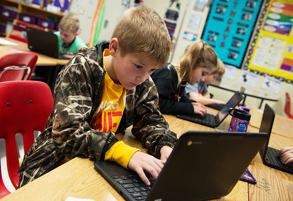 Globe/Roger Nomer<br /> Mackinley Evans, Mark Twain Elementary third grader, works on a blog on Tuesday at the school.