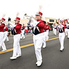 The Joplin High School Eagle Pride Marching Band makes its way down Main Street during the Veterans Day Parade on Saturday in downtown Jolin.<br /> Globe | Laurie Sisk