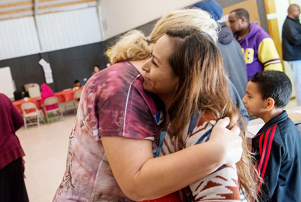 Globe/Roger Nomer<br /> Michelle Wilson, ESL teacher with Crowder, left, greets her student Martha Maldonado during Monday's Thanksgiving lunch at the Noel Community Center.