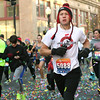 Gavin Page makes his way through the confetti at the start of the Joplin Turkey Trot 5k race in downtown Joplin on Thanksgiving morning. About 1,700 runners particpated in the event.<br /> Globe | Laurie Sisk