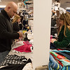 Globe/Roger Nomer<br /> Shawn Daniel, with the Young Professionals Network, and Heather Collins, with Missouri Southern Leadership Cabinet, sort clothes on Monday evening at Crosslines. The two organizations volunteered at Crosslines during commodity night.