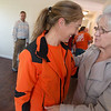 Globe/Roger Nomer<br /> Ellen Quinn, services supervisor for Home Depot in Harrison, Ark., congratulates Charlotte King on her new Habitat home on Friday.