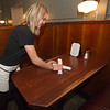 Server Lauren Joyner prepares a booth for evening dining on Thursday at Wilder's. The restaurant has long been one of the local favorites for fine dining in Joplin.<br /> Globe | Laurie Sisk
