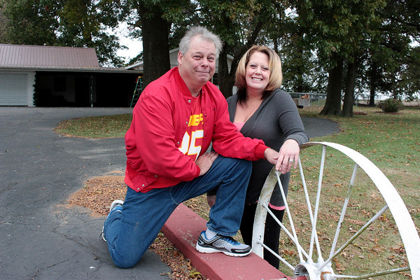Rob and Susan Curtis, of Jasper, are pictured with their home as they prepare for their annual Christmas lights display. Months of work go into the display, and this year the couple are excited for the newly added Christmas forest. Everyone is welcome to come enjoy the scene at 310 S. 4th St., Thanksgiving through Christmas. Rebecca Haines / Special to the Globe