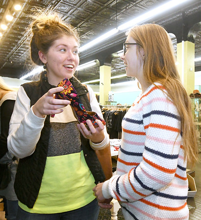 From the left: Emmy Dagnan and her sister, Elexa Dagnan look over the selection of shoes on Wednesday at Sophie. Downtown shop owners are busy preparing for Small Business Saturday.<br /> Globe | Laurie Sisk