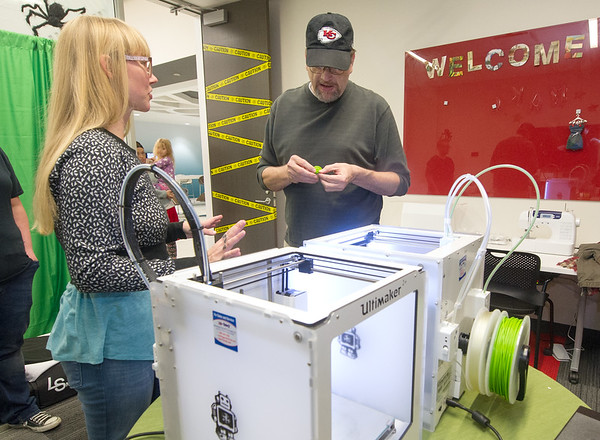 From the left: Jill Sullivan, Post Art Library director at the Joplin Public Library, shows David Harris, of Diamond the 3D printer at the library's Makerspace open house on Saturday. The Makerspace offers 3d printing for a nominal materials fee as well as other instruments of technology and manufacturing.<br /> Globe | Laurie Sisk