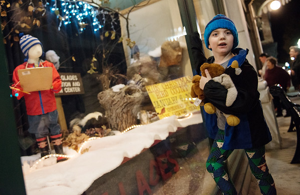 Globe/Roger Nomer<br /> Jansen Busby, 6, looks at a window from Wildcat Glades Conservation and Nature Center on Monday at Joplin City Hall.