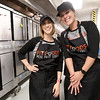 From the left: Fit Foods Meal Prep Service owners Amy Sallee and Tricia Douglas take a break from prepping meals at the Webb City Farmers Market earlier this month.<br /> Globe | Laurie Sisk