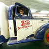 From the left: Phillip Gomez and Emily Vue dust off a 1938 Pepsi delivery truck on loan from the Farabi on Thursday at the museum. The two are both Circle K members at Pittsburg State.<br /> Globe | Laurie SIsk