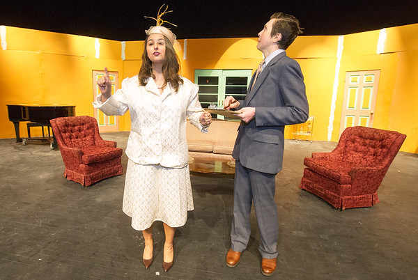 """Joplin High School thespians Jessica Stout (Mrs. Osgood) and Jakob Butler (Mr. Dunlap) rehearse their roles in the 1940s era farce, """"Suite Surrender"""" on Friday at the JHS Performing Arts Center.<br /> Globe 