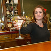 Wilder's server Rhea Brown serves a dronk on Thursday at the popular restaurant.<br /> Globe | Laurie Sisk
