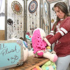 Ten-year-old Hadlee Meadows, 10, of Liberal, checks out the crocheted stuffed animals at Melinda Brown's Maple and Orange booth during the Art Feeds Hip Handmade Market on Saturday at the Roxy Event Center.<br /> Globe | Laurie Sisk