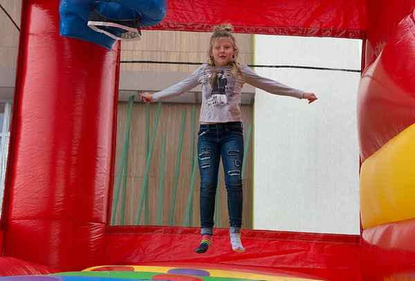Globe/Roger Nomer<br /> Laekyn Smotherman, 8, Webb City, plays in a bounce house set up by the Joplin Area Firefighters on Friday at Panda Express. The public safety event helped promote the upcoming Christmas for Kids and Operation Warm programs by the firefighters, and 20% of Panda Express sales during the event went to the programs.