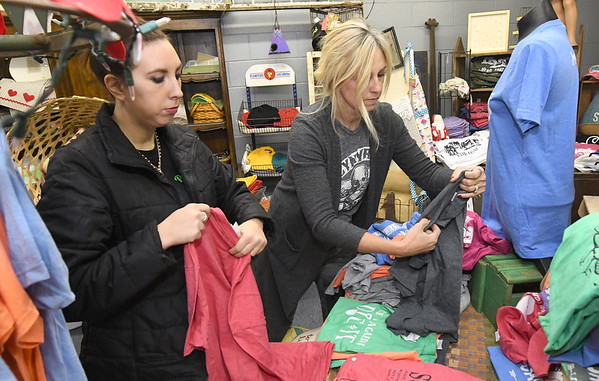 From the left: Rust & Stuff coowners Kallie McDaniel and Kathie England-Hinds fold shirts Wednesday in preparation for Small Business Saturday at their downtown store.<br /> Globe | Laurie Sisk