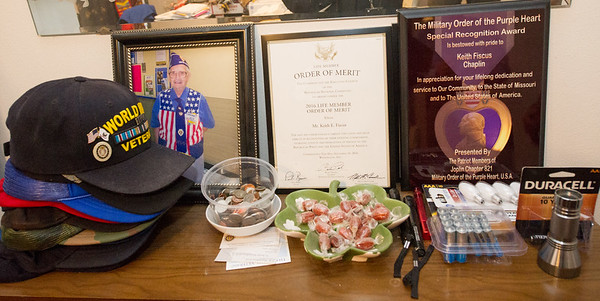 Articfacts from World War II veteran Keith Fiscus' service rest side-by-side with everyday items at his Joplin home. Fiscus will be serving as Grand Marshall for the Veterans Day Parade in downtown Joplin today.<br /> Globe | Laurie Sisk