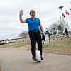 Ali Fant rides her unicycle on the campus of Missouri Southern on Tuesday.<br /> Globe | Roger Nomer