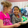 Alexis Osborn, left, and Mireida Alvarado read a book together during kindergarten class at Fairview Elementary in Carthage on Monday.<br /> Globe | Roger Nomer