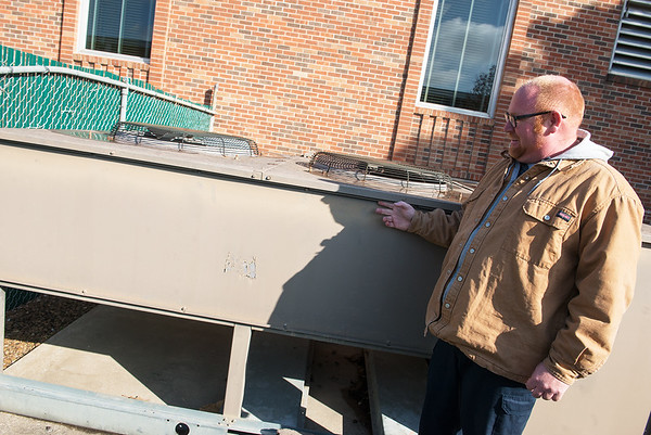 Bryan Goodwin, Missouri Southern Physical Plant director, talks about the condensing units at Kuhn Hall on Monday.<br /> Globe | Roger Nomer