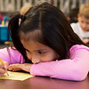 Odalys Tebalan, first grade, works on an assignment on Monday at Fairview Elementary.<br /> Globe | Roger Nomer