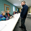 From the left: Election judges Gail Orr and Marlene Bryan check in Robert Ruble as he prepares to vote in the 2018 Midterm Election on Tuesday at First United Methodist Church. Officials reported a heavy turnout at the site.<br /> Globe | Laurie SIsk