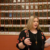 Olivia Enlow, freshman, practices her debate skills on Tuesday at Neosho High School. Behind her are plaques from National Qualifiers from Neosho High.<br /> Globe | Roger Nomer