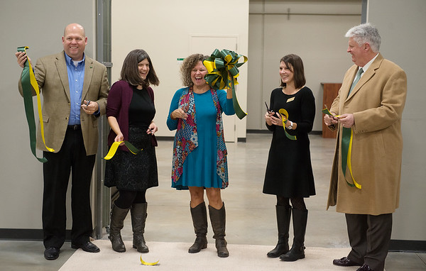 The ribbon is cut for the new Lion Co-Op food pantry on Tuesday. Globe | Roger Nomer