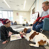 "Seven-year-old Annabelle Lucas reds to ""Brooks,"" a Brittany spaniel as owner Tom Kearney looks on during Dog Day Afternoon on Tuesday at the Joplin Public Library. The recurring event allows children to practice their reading skills in front of a non-judgmental audience.<br /> Globe 
