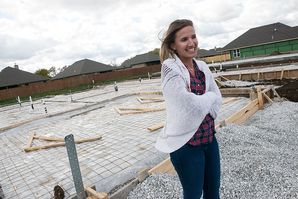 Courtney McNally, marketing manager for Schuber Mitchell Homes, talks about a house that will be a fundraiser for St. Jude Hospital during an interview on Friday at the house's site in Webb City.<br /> Globe   Roger Nomer