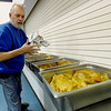 Salvation Army cook Rusty Long on Thursday night unwraps some of the 25 turkeys that will feed a projected 400 to 500 guests on Thanksgiving Day at the Salvation Army. More than 50 volunteers from Missouri Southern's Zeta Tau Alpha sorority volunteered their time to debone the turkeys on Thursday night. <br /> Globe | Laurie Sisk