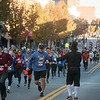 Runners close in on the finish line during Thursday's Turkey Trot 5K in downtown Joplin on Thursday.<br /> Globe | Roger Nomer