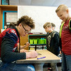Isaiah Davis, a Joplin High junior, signs an autograph fro Grayson Heritage, a third grader at Kelsey Norman on Friday.<br /> Globe   Roger Nomer
