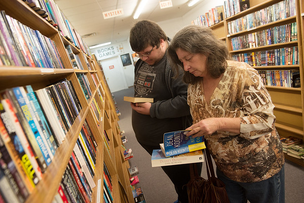 James Garrett and Susan Goldberg browse books at Changing Hands Book Shoppe on Friday.<br /> Globe | Roger Nomer