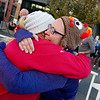 Nicki Lopez, Webb City, left, and Dawn Woody, Madison, Mo., embrace after finishing Thursday's Turkey Trot 5K in downtown Joplin.<br /> Globe | Roger Nomer