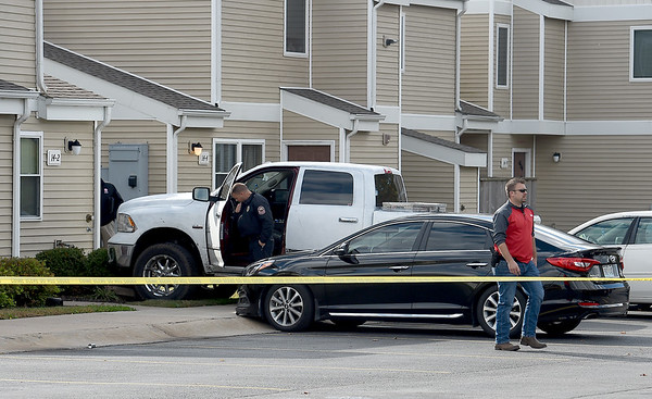 Joplin Police look over a stolen vehicle that led to an officer-involved shooting early Friday afternoon in the playground of the Springhill Apartments near 21st and McCoy streets.<br /> Globe   Laurie Sisk
