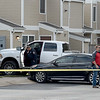 Joplin Police look over a stolen vehicle that led to an officer-involved shooting early Friday afternoon in the playground of the Springhill Apartments near 21st and McCoy streets.<br /> Globe | Laurie Sisk