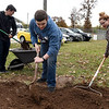 From the left: Crowder College students Keller Wilson, Jonathan Blewett and Stormy Tramell shovel dirt to fill holes in the grounds at the Faithful Friends animal shelter on Saturday in Neosho. About 60 volunteer students completed a variety of tasks Saturday at the shelter.<br /> Globe | Laurie SIsk
